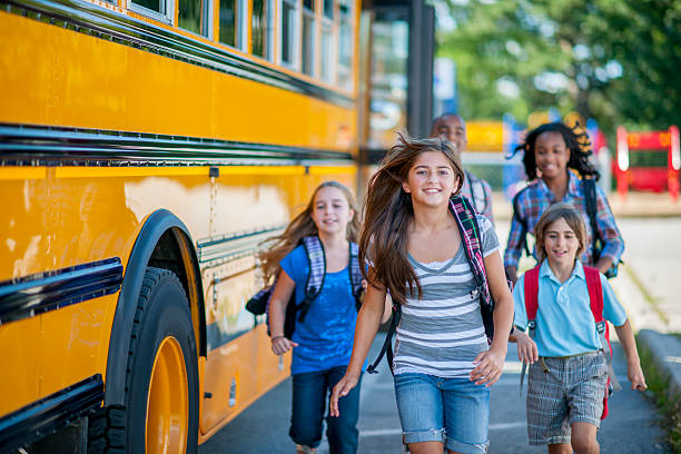 students going to school - school bus stock photos and pictures