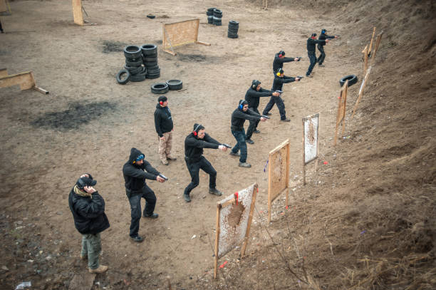 students group with instructors practice gun shooting on shooting range - training imagens e fotografias de stock