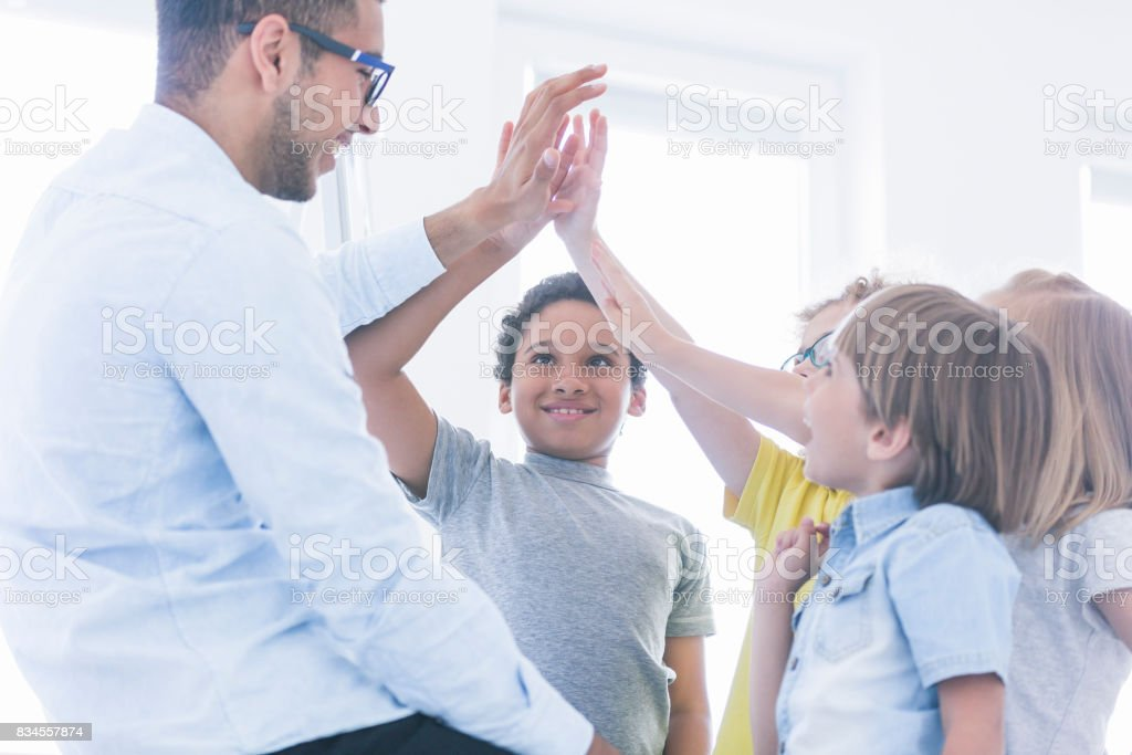 Students have fun with teacher stock photo
