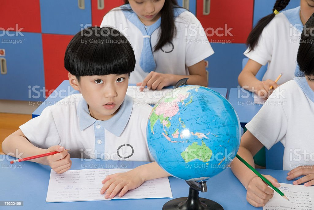 Students having a geography lesson 免版稅 stock photo