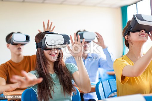 682285886 istock photo students having fun with new technology vr headset in classroom 1145550695