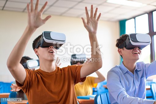 istock students having fun with new technology vr headset in classroom 1145550775