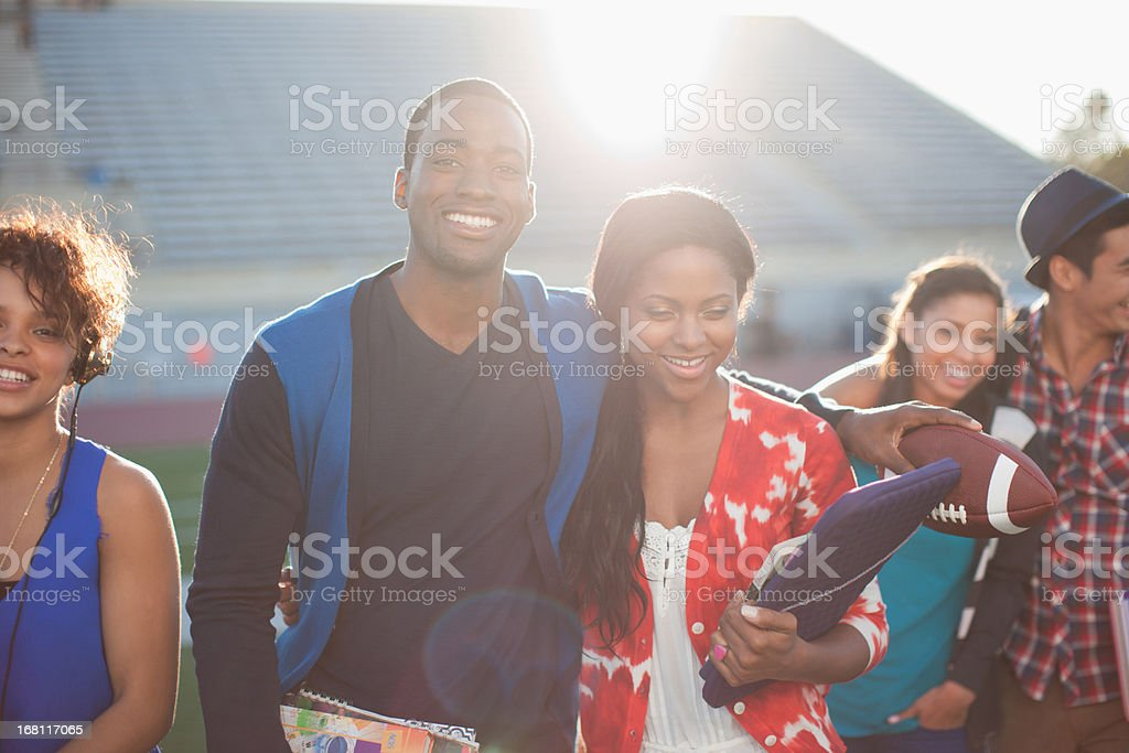 Students hugging on football field royalty-free stock photo