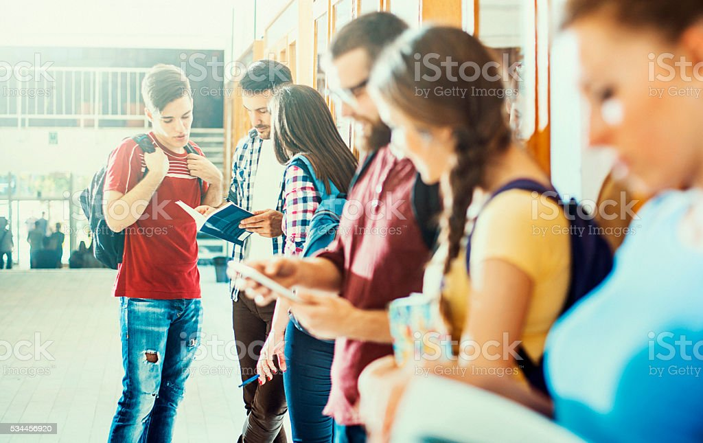Students in a hallway. stock photo