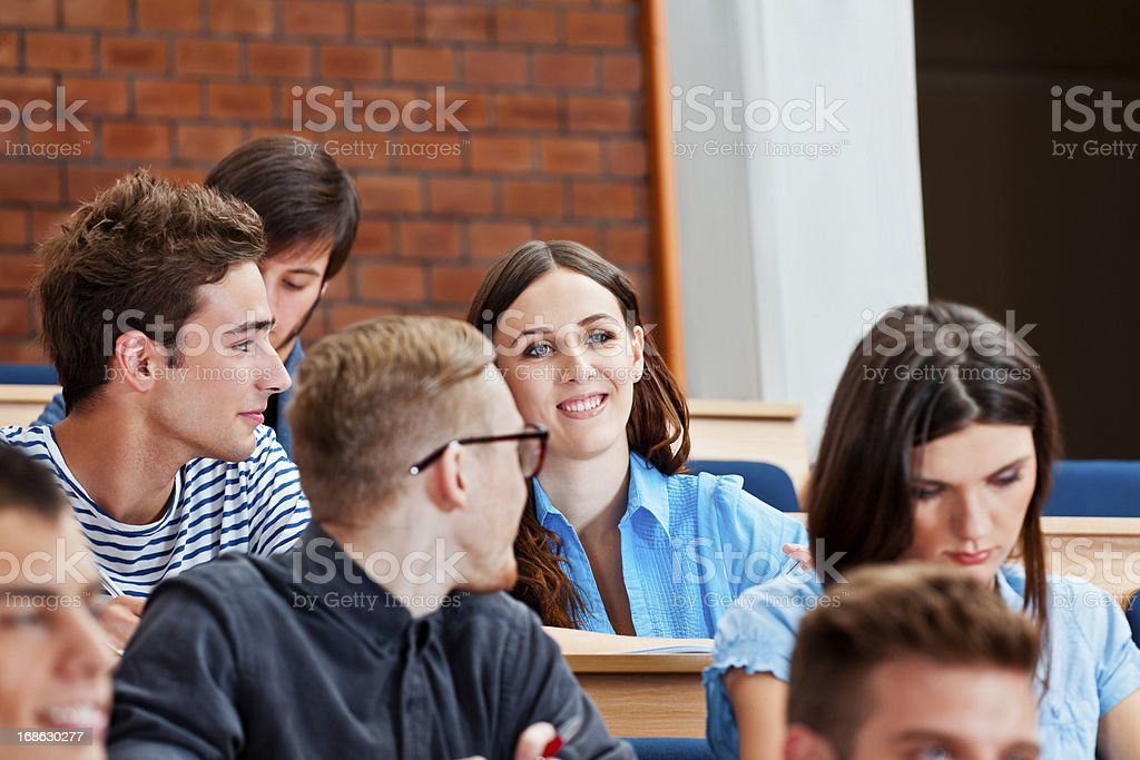 Students in a lecture hall Group of high school students sitting in the lecture hall at university and listening to a lecture. 20-24 Years Stock Photo