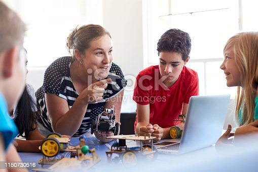 istock Students In After School Computer Coding Class Building And Learning To Program Robot Vehicle 1150730516