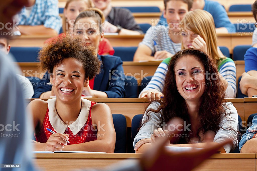 Students in lecture hall Large group of high school students sitting in the lecure hall and listening to their professor.  20-24 Years Stock Photo
