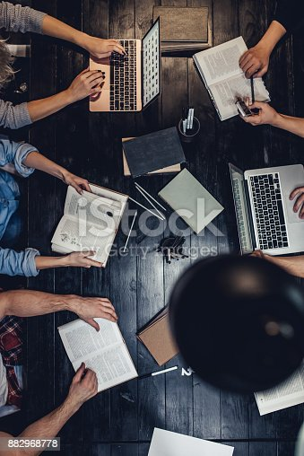 istock Students in library. 882968778