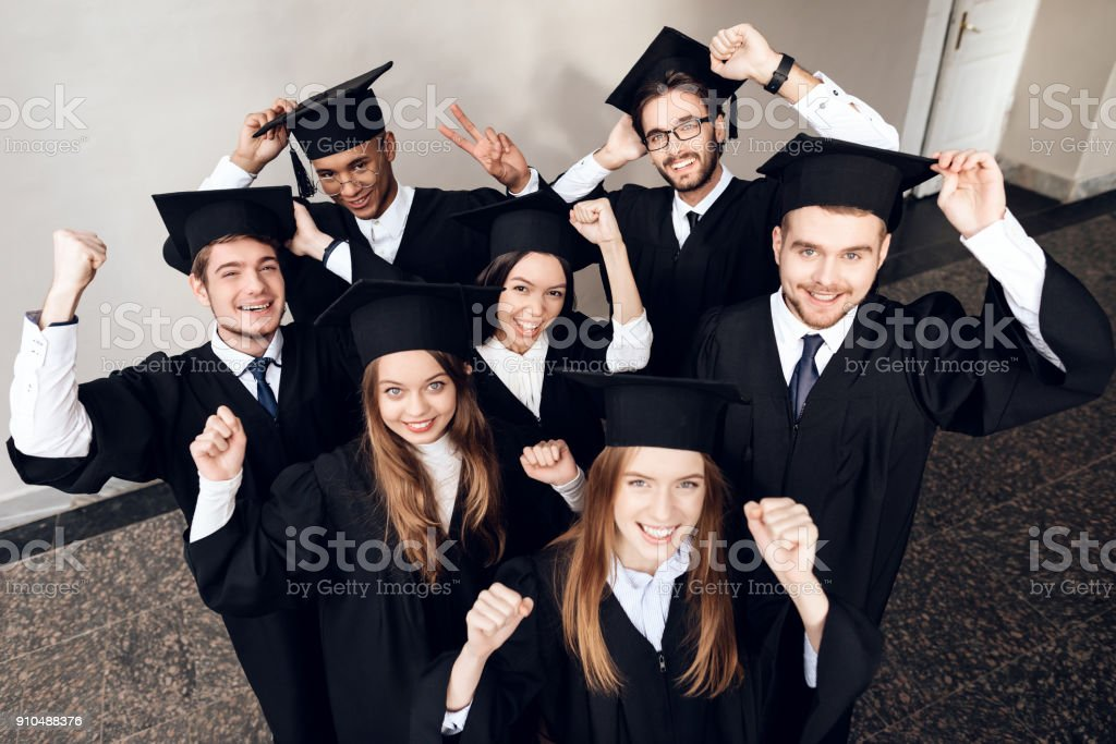 Students in mantles are happy that they finish their studies at the university. stock photo