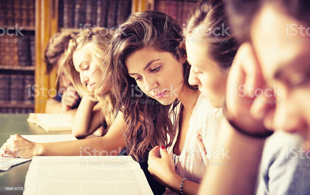 Students in the library studying together royalty-free stock photo