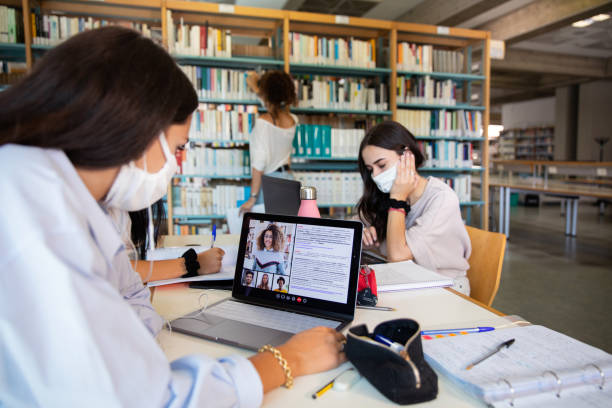 Students in video-conference and studying for the next exam stock photo