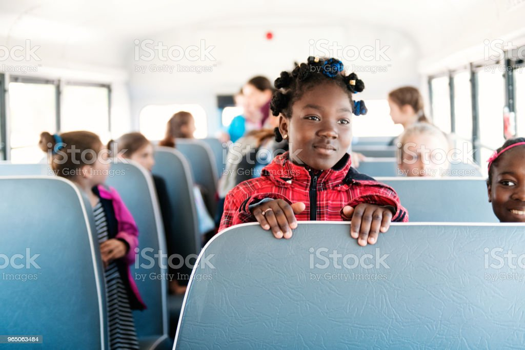 Students inside a school bus at the school's out royalty-free stock photo
