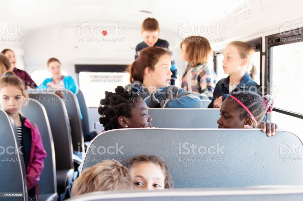 Students inside a school bus at the school's out zbiór zdjęć royalty-free