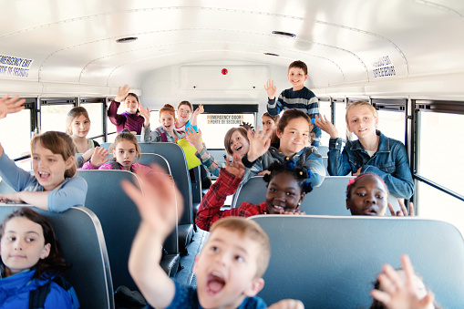Students Inside A School Bus At The Schools Out Stock Photo - Download Image Now