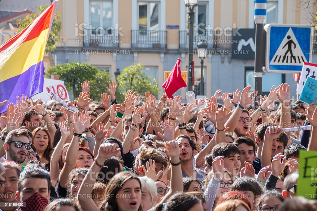 Madrid, Spain - October 26, 2016 - Students keeping hands up at...