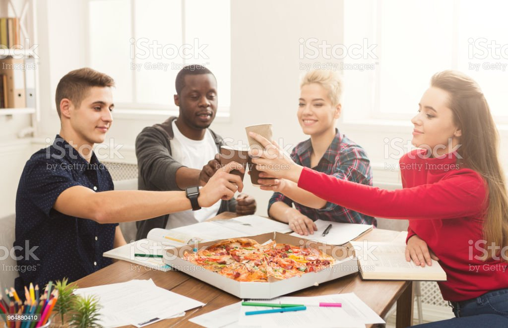 Students learning and eating pizza royalty-free stock photo