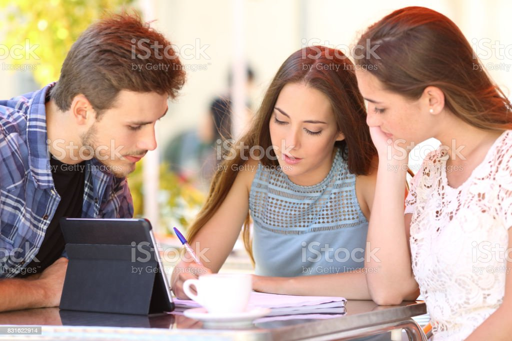 Students learning in a bar stock photo