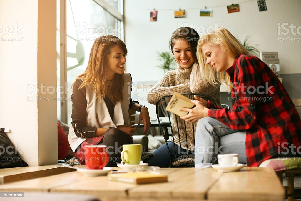 Students learning in a cafe. stock photo