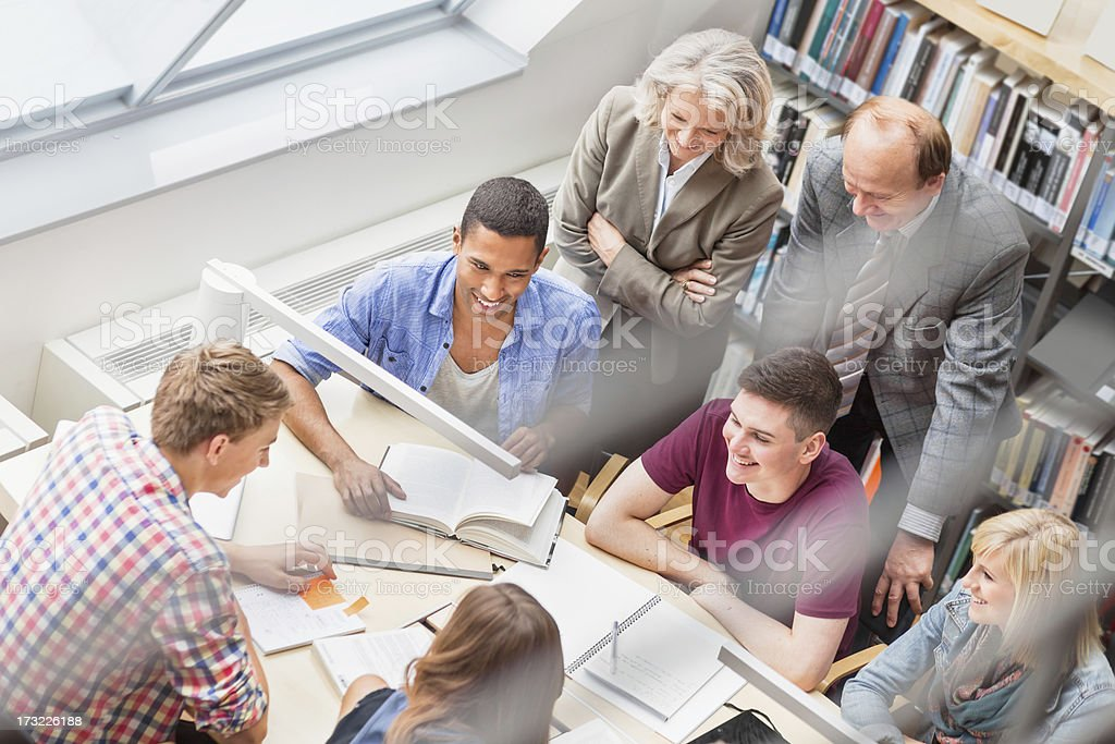 Students Learning In Library royalty-free stock photo