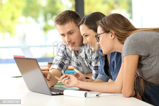 istock Students learning together on line in a classroom 820890292
