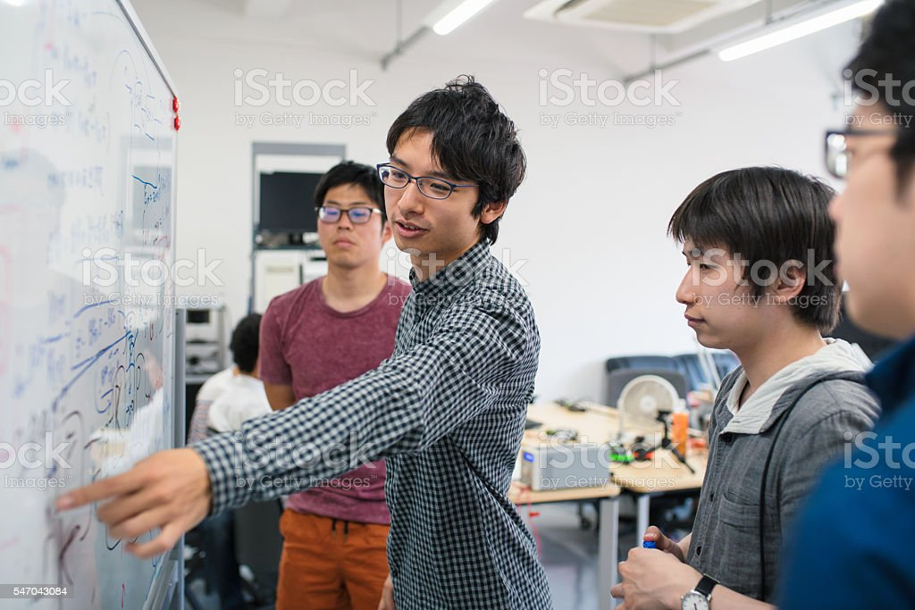 Students looking at scientific formula ストックフォト