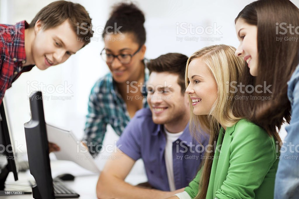 students looking to computer monitor at school royalty-free stock photo
