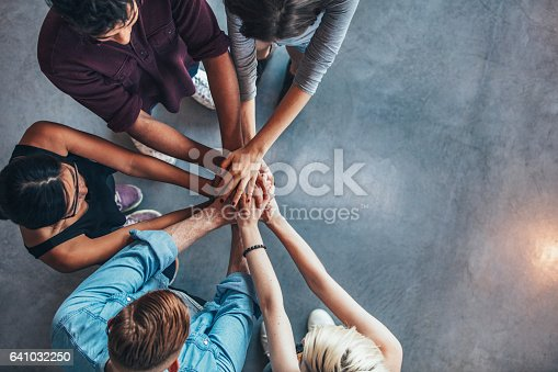 istock Students making a stack of hands 641032250