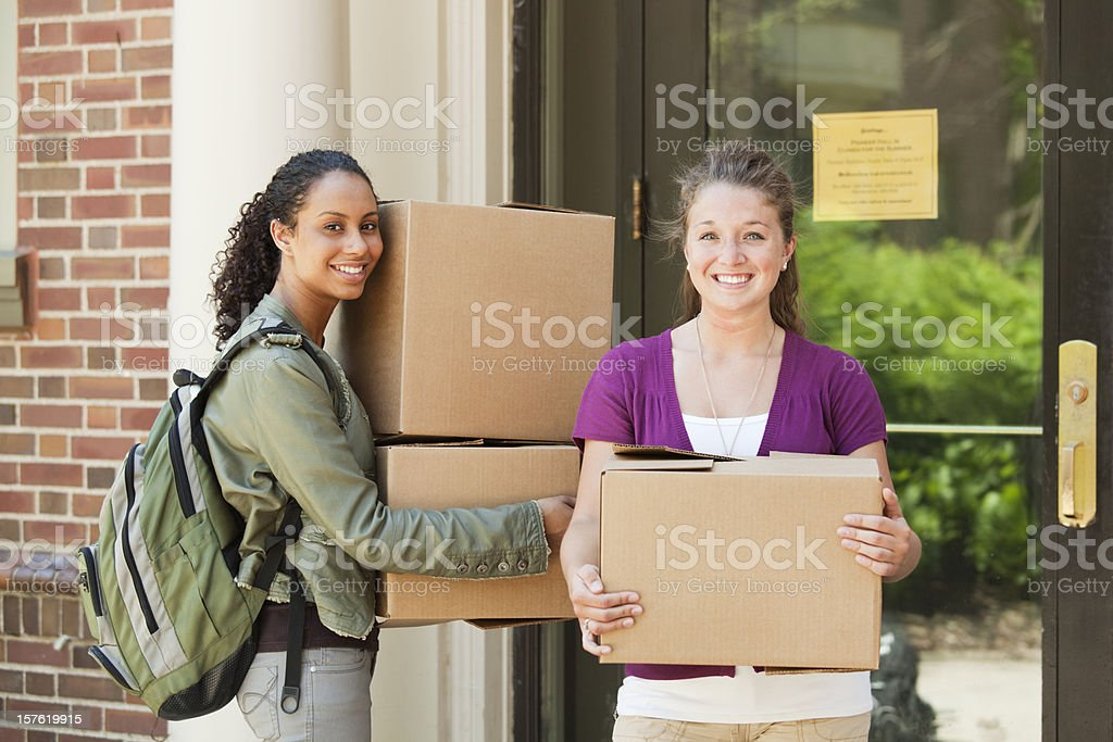 Students Moving Boxes in College Dorm Apartment on University Campus royalty-free stock photo
