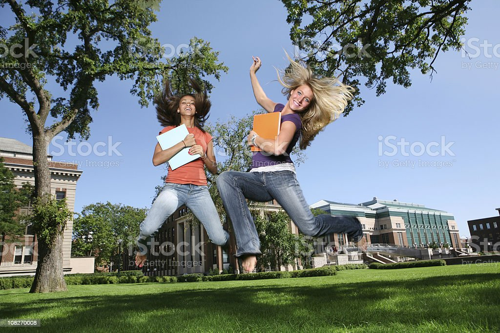 Students on Campus Jumping for Joy royalty-free stock photo