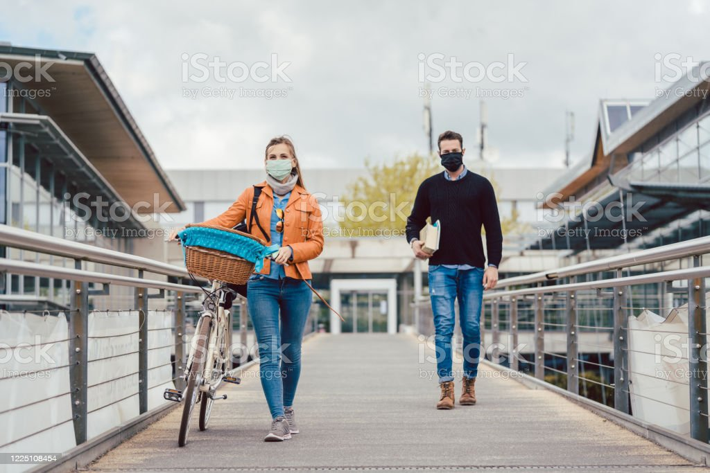 Students on university campus wearing masks during coronavirus crisis Students on university campus wearing masks during coronavirus crisis keeping social distance Adult Stock Photo