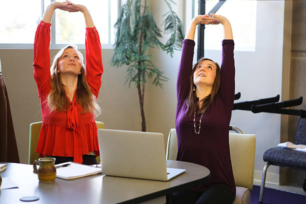 Students or Young Business Women Doing Yoga Stretching Working Studying - foto de stock