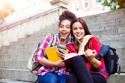 istock Students outdoor with books 618553722