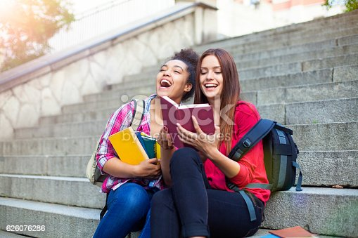 istock Students outdoor with books 626076286