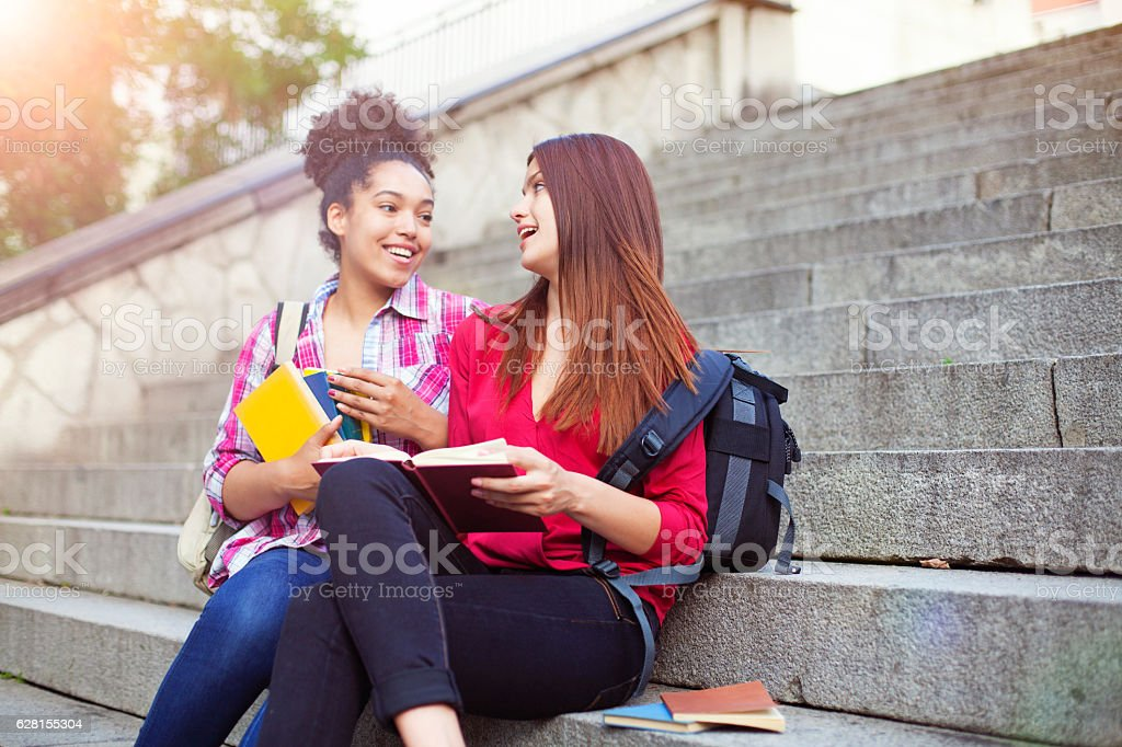 Students outdoor with books stock photo
