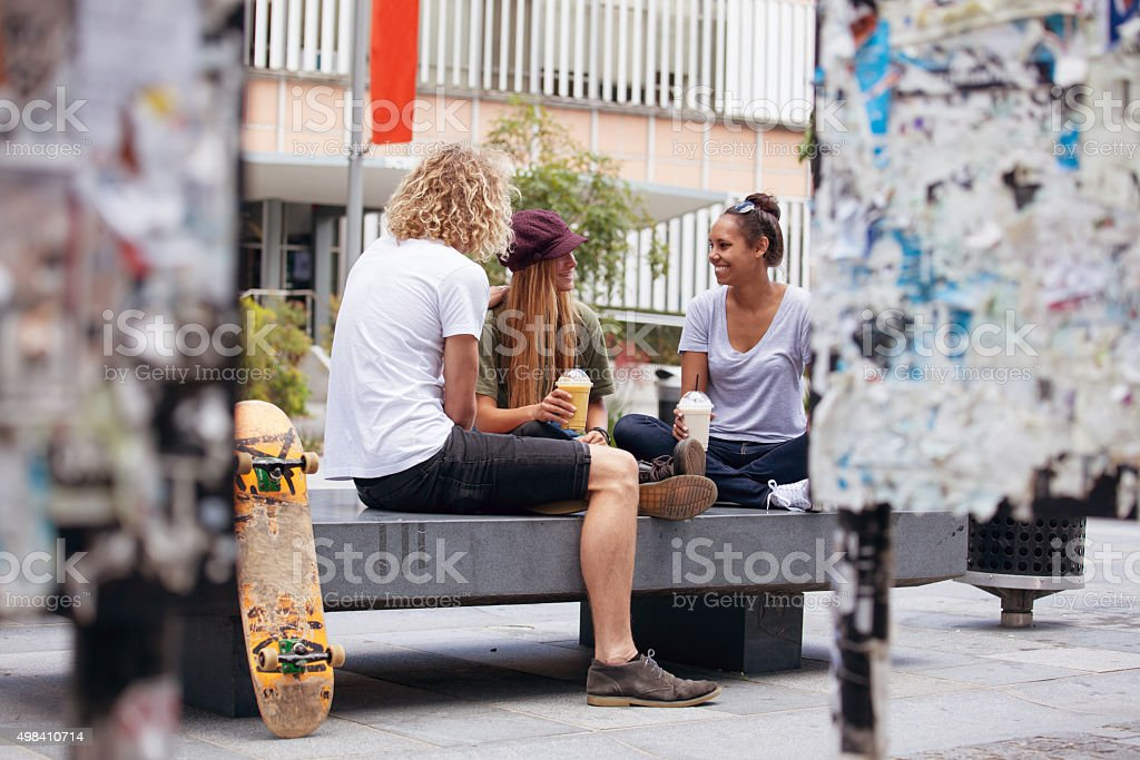 students outside in conversation stock photo