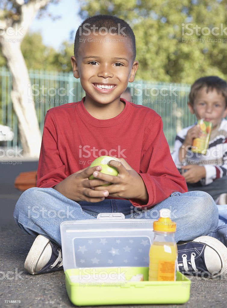 Students outside of school eating royalty-free stock photo