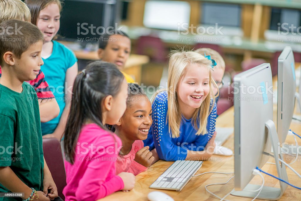 Students Playing a Computer Game stock photo