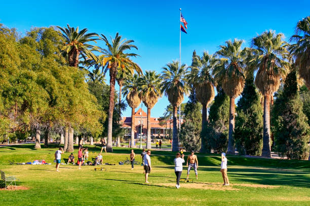 Students playing a form of volleyball on the University of Arizona Campus in Tucson AZ stock photo