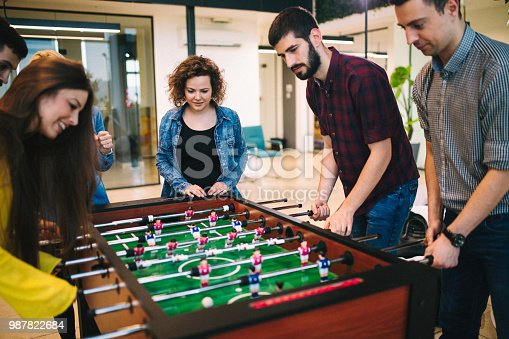 Students playing table soccer