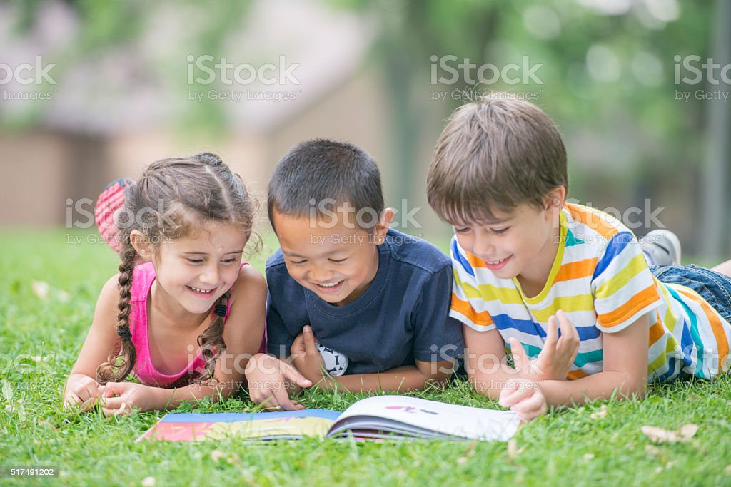 Students Reading a Book at the Park stock photo