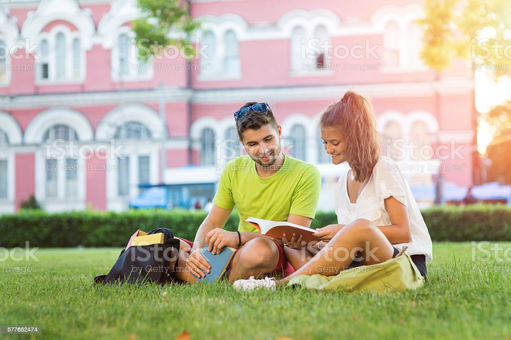 Students reading in the campus stock photo