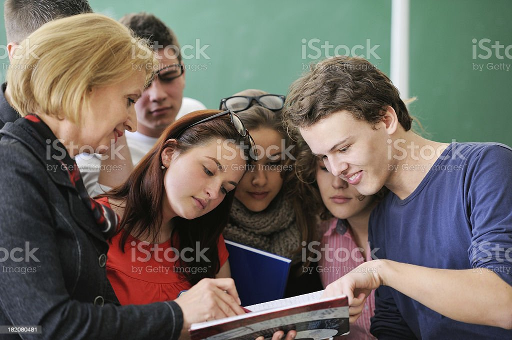 Students reading with a professor stock photo
