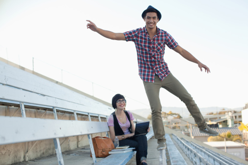 istock Students relaxing on bleachers 168116754