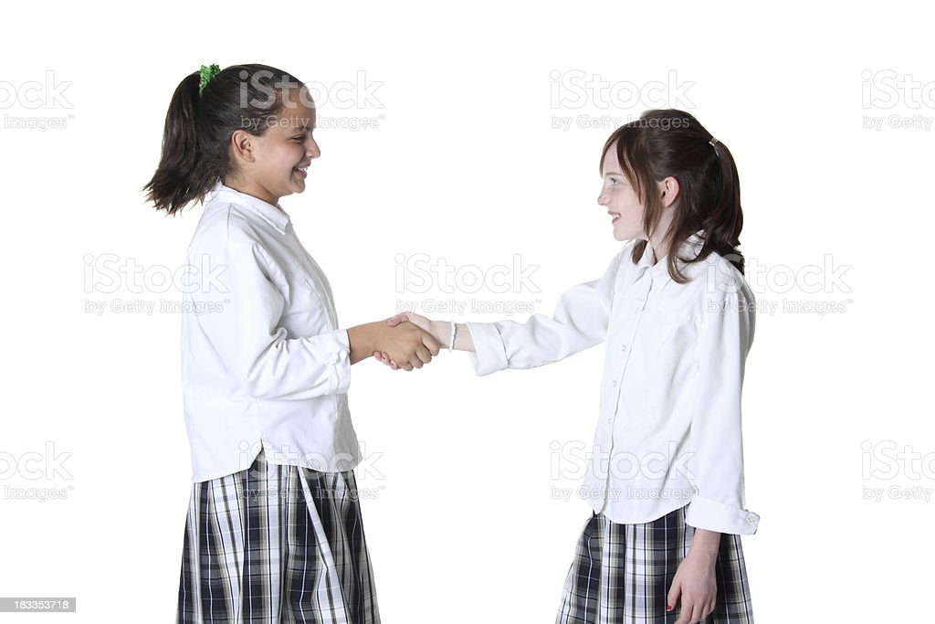 Students Shaking Hands stock photo