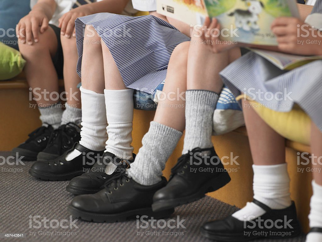 Students Sitting In Row Classroom stock photo