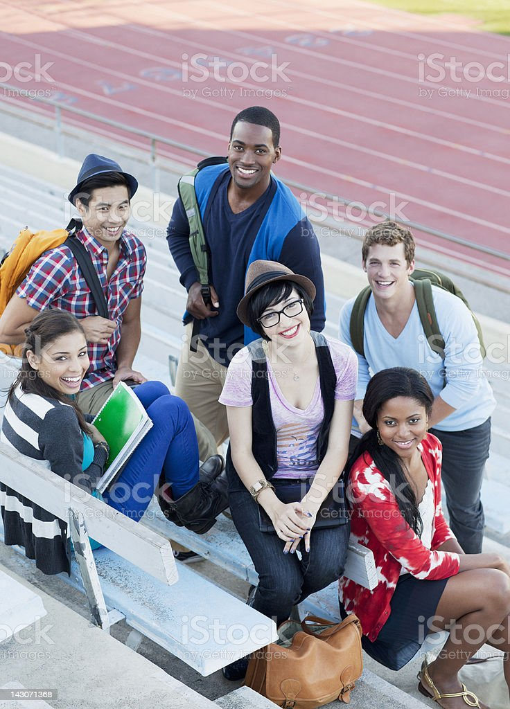 Students sitting together on bleachers royalty-free stock photo