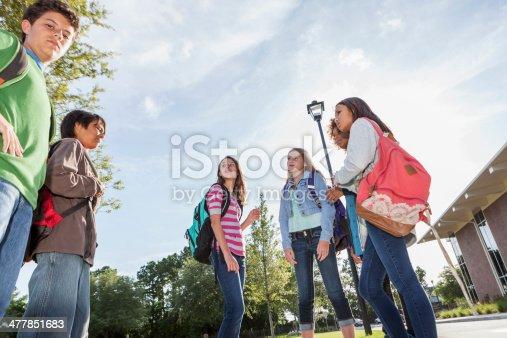 476098743 istock photo Students standing outside school 477851683