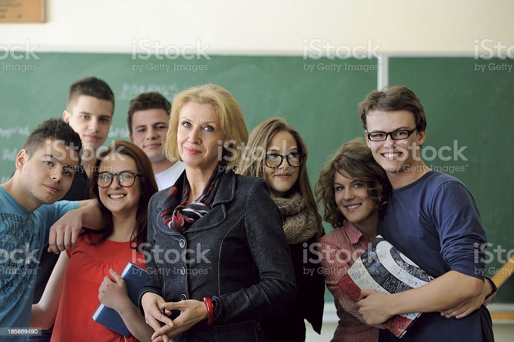 Students standing with teacher stock photo