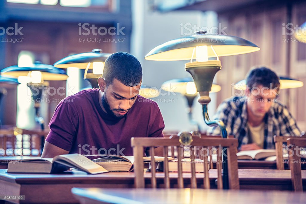 Students studying in a public library stock photo