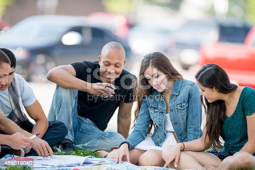 istock Students Studying Together Outside 488519040